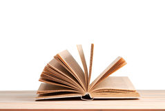 Open book isolated on wooden table. Back to school. Copy space.  Royalty Free Stock Photo