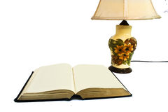 Open book with lamp Stock Photos