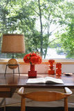 Open Book, Lamp And Retro Ornaments On Desk Stock Photo
