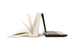 Open book and laptop. Book and laptop on isolated white background Stock Image