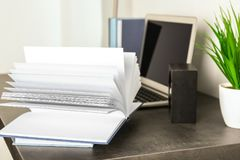 Open book and laptop stock images
