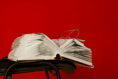 Open book laying on the chair Stock Photography
