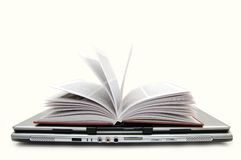 The open book laying on the laptop Royalty Free Stock Photography