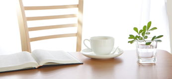 An open book with leaf decoration and coffee Stock Photography