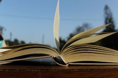 Open book and leafed by the wind. Blue sky in the foreground royalty free stock images