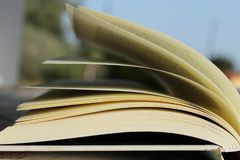 Open book and leafed by the wind. Blue sky in the foreground stock photos