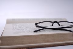 Open Book and Lenses Stock Photography