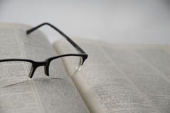 Open Book and Lenses Royalty Free Stock Images