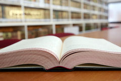 Open book in library Royalty Free Stock Images