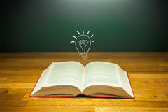 Open book with light bulb for idea concept Stock Image