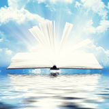 Open book with light insideout Stock Photos
