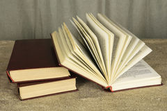 Open book lying on a wooden table royalty free stock photo