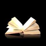 Open book magic. On black Stock Photo