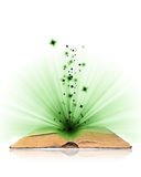 Open book magic. On white royalty free stock images