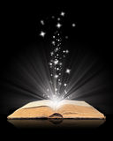 Open book magic on black Royalty Free Stock Photo