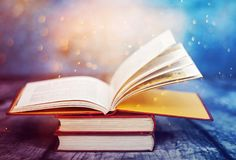 Vintage open book. Open book with magic lights. Concept of wisdom, religion, reading, imagination, winter holidays Royalty Free Stock Image