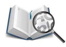 Open book with magnifying glass Royalty Free Stock Photo