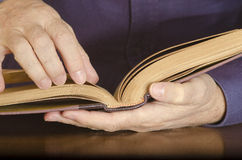 Open Book in Man's Hands Stock Photos