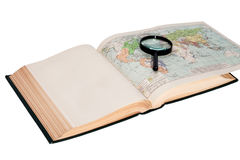 Open book with a map and magnifying glass Stock Photo
