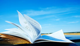 Open book. Open music book on sky background. music education Stock Photo