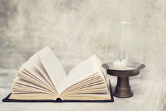 Open book and near the lamp Royalty Free Stock Images