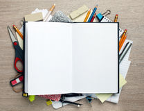 Open book with office supplies Stock Images