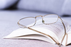 Open book with old glasses Royalty Free Stock Images