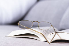 Open book with old glasses Stock Image