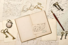 Open book, old letters, antique accessories. Vintage background Stock Image