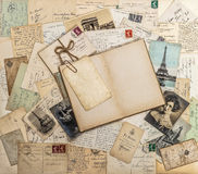Open book, old letters and postcards. Travel memories scrapbook Royalty Free Stock Photography