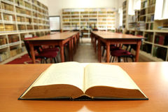 Open book in old library Royalty Free Stock Photo
