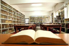 Open book in old library Stock Photo