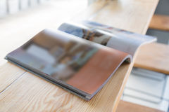 Open  book on old wooden table. Open diary or photo album book on old wooden table Stock Image