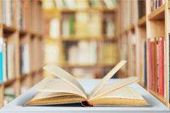 Open book on old wooden table in library. Open book open book background nobody paper closeup Royalty Free Stock Photo