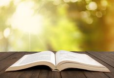 Open book on old wooden table. Open book open book background nobody paper closeup Stock Image