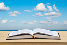 Open Book On Desk And Sea Royalty Free Stock Photos