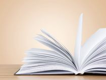 Open book on old wooden table. Open book open book background nobody paper closeup Royalty Free Stock Photo