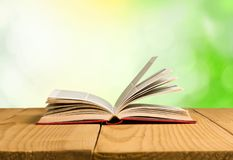 Open book on old wooden table. Open book open book background nobody paper closeup Royalty Free Stock Photos