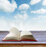 Open book. On deck in front of sky Royalty Free Stock Image