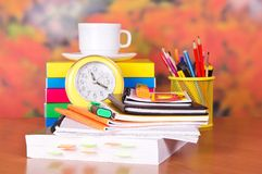 Open book and other school supplies Stock Photo