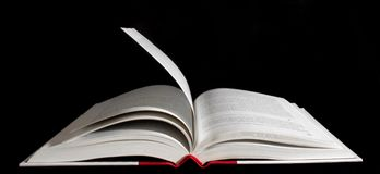 Open book over black background Royalty Free Stock Image