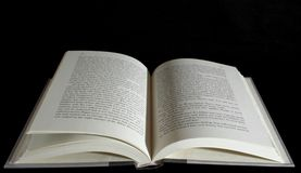 Open book over black background Stock Photos