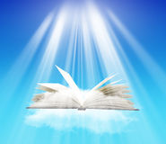 Open book  over blue sky. And sunlight Stock Photo