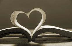 Open book with pages forming heart shape . stock photo