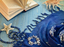Open book, pareos and starfish Stock Image