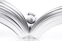 Open book and pen. On white background Stock Photo