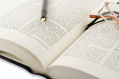 Open book and pen. Open book, pen and glasses stock image