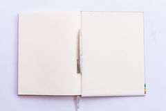 Open book with pen in last page. Open book with pen in blank pages.  with white background Stock Photos