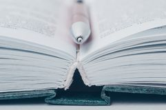 Open book. A pen lies between the pages in an open book stock images