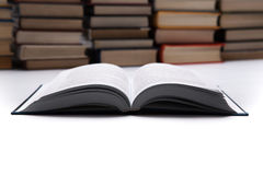 Open book on with pile of books. Close up Stock Photos